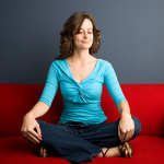 woman meditating, showing stress reduction helping end migraines